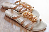 Ladies beige sandals low heels — Stock Photo