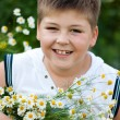 Royalty-Free Stock Photo: Boy with field daisies