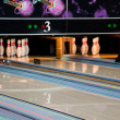 Stock Photo: Bowling lanes with pins
