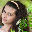 Teen girl with blooming bird cherry - Stock Photo