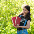 Teen girl with books on nature — Stock Photo #25522887