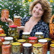 Womwith home canning for winter — Stock Photo #31825375