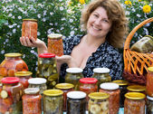 Woman with home canning for the winter — Stock Photo