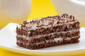 Chocolate cake on a yellow background — Stock Photo