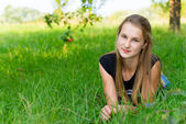 Young girl is resting in nature — Stock Photo