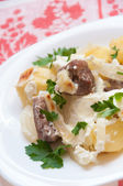 Baked potatoes with meat in a creamy sauce — Photo