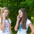Teen girls talking on cell phone — Stock Photo