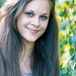 Teen girl near the birch — Stock Photo #36715287