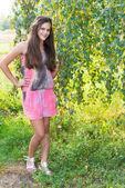 Teen girl near the birch — Stock Photo