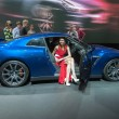 A model presents a car at the Moscow International Motor Show 2012 — Stock Photo