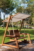 Bench swing with canopy outdoors — Stok fotoğraf