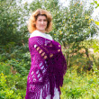 Stock Photo: Womin knitted shawl in nature