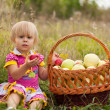 Stockfoto: Little girl with basket of fresh apples