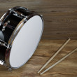 Drum and drumsticks — Stock Photo