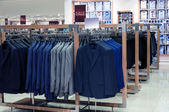 Menswear store with jackets — Stock Photo