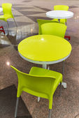 Plastic tables and chairs in a cafe — Stok fotoğraf