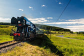 Train with a steam locomotive — Stock Photo
