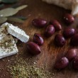 Olives on a wooden table and feta cheese — Stock Photo #41352383