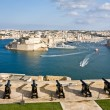 Grand Harbor and medieval cannons battery, Valetta, capital of M - Stock Photo