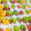 Fruits in plastic caps — Stock Photo