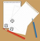 Caderno e lápis de cor — Vetor de Stock