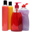 Four colored plastic bottles with liquid soap and shower gel isolated on white background — Stock Photo #21131743
