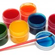 Children's paints in jars and brush - Stock Photo