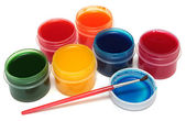 Children's paints in jars and brush — Stock Photo