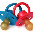 Two baby's dummy red and blue — Stock Photo
