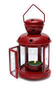 Red metal lamp with candle. — Stockfoto