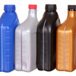 Plastic bottles from automobile oils isolated on a white background — Stock Photo #34523481