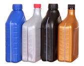 Plastic bottles from automobile oils isolated on a white background — Stock Photo