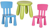 Three children's plastic chairs isolated on white background. — Stock Photo