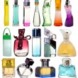 Colored glass bottles of perfume isolated on white background. — Stock Photo