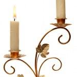 Burning old candle vintage golden candlestick. — Stock Photo