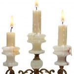 Burning old candle vintage golden candlestick. onyx — Stock Photo