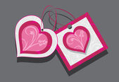 Ornamental hearts. Two tags isolated on the gray — Stock Vector