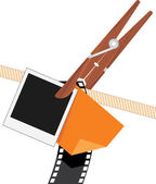Clothespin with photo objects on a rope — Stock Vector