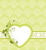 Bloeiende takje met hart op de decoratieve achtergrond — Stockvector