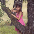 Foto Stock: Girl in pink dress