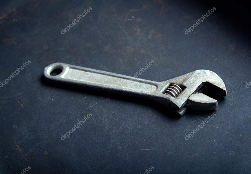 Pipe wrench on a dark background closeup. — Stock Photo #16897611