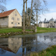 Kronovall's castle with water reflection — Stock Photo