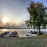 Swedish lake boat harbor in autumn season — Stock Photo #39765097