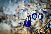 Eye-shaped amulets to protect against the evil eye — Stock Photo