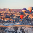 Stock Photo: Balloons over Uchisar castle in Cappadocia