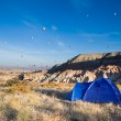 Tent and many balloons above Cappadocia — Stock Photo