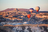 Balloons over Uchisar castle in Cappadocia — Stock Photo