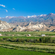 Village in bizarre scenic Tien Shan mountains — Stock Photo