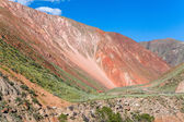 Vibrant red colored mountain in Kyrgyzstan — ストック写真
