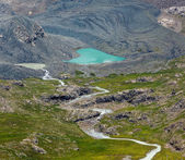 Heart-shaped lake and river flowing from glacier — Stock Photo